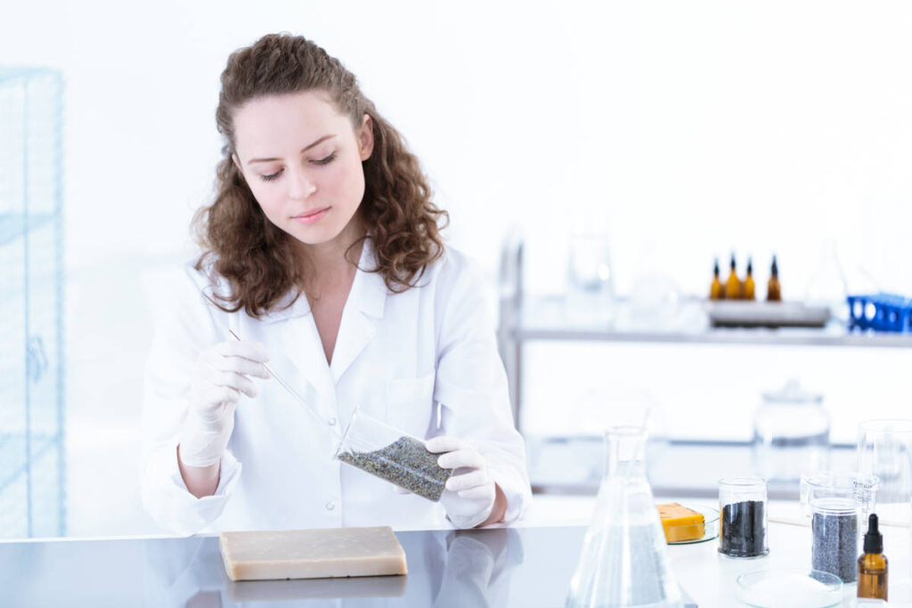 Scientist working with chemical substances in a white lab